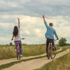 The man and woman riding a bike outdoor